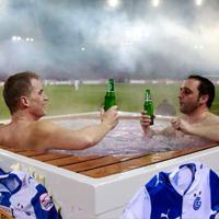 Switzerland: Enjoying the game from... jacuzzi