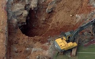 USA: Large sinkhole just behind the pitch
