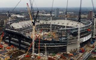 London: First tiles decorate Tottenham stadium's facade